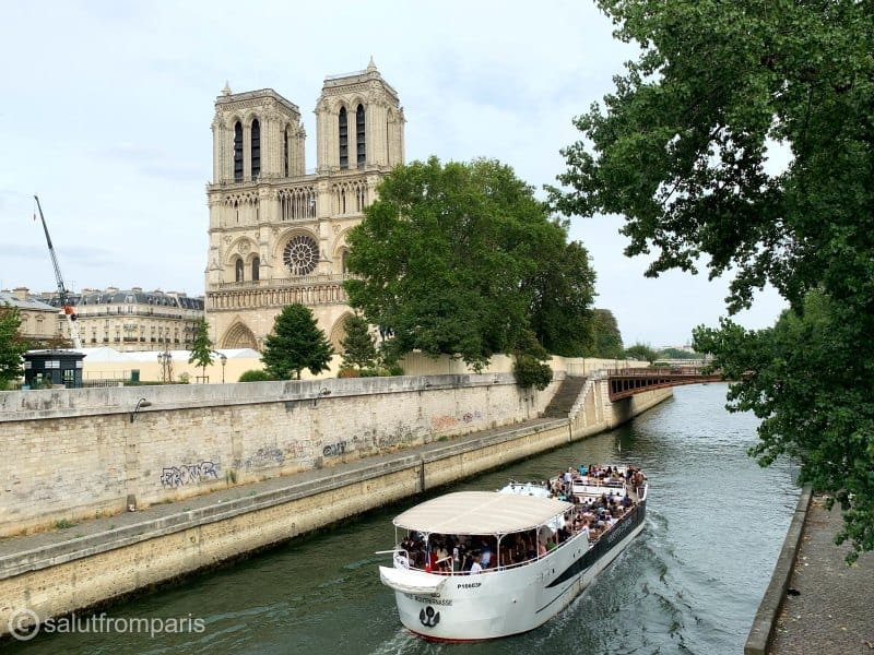 All Seine river cruises are sailing along the Notre Dame Cathedral, that got heavily damaged by a fire in April 2019.