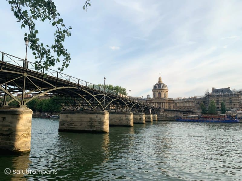 The Pont des Arts is one of the bridges you will underride when taking a Cruise on the Seine in Paris. A Paris boat tour is one of the best things to do in Paris to change perspective and to relax while seeing most of Paris' sights
