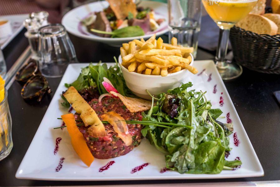 a staek tartare is one of the classic french dishes to eat in a brasserie