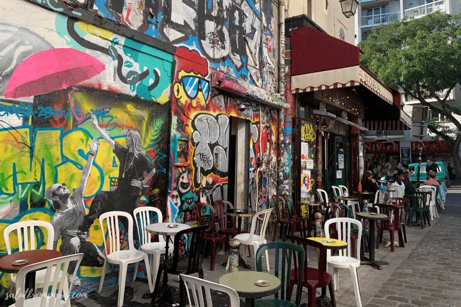 The most famous graffiti street of Paris — Rue Denoyez. The layers of paint are centimeter thick.